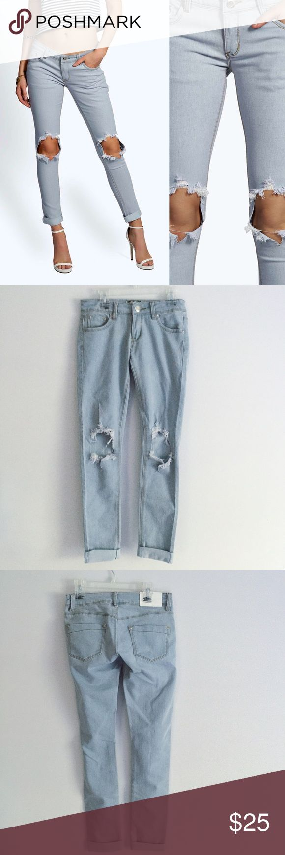 Petite Knee Rip Skinny Jeans NWOT low-rise cuffed skinny jeans in a light wash ripped at the knees. Fit more like a 0 than a 2. Boohoo Jeans Skinny
