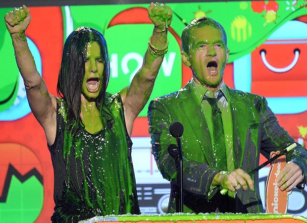 Sandra Bullock and Neil Patrick Harris get slimed at the 2013 Nick Kids' Choice Awards