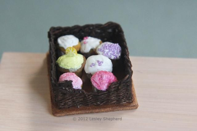 Use traditional weaving techniques for a wood bottomed basket to make this miniature pastry basket for a dollhouse bakery or tearoom scene. The method can also be used to make simple woven drawers.