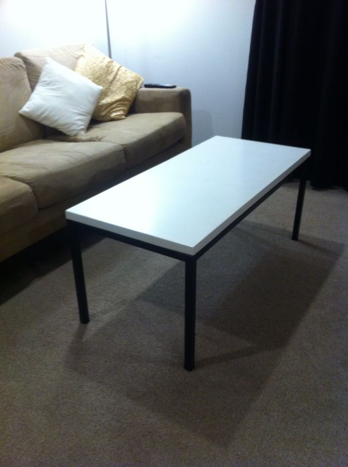 White concrete table top with recycled coffee table frame