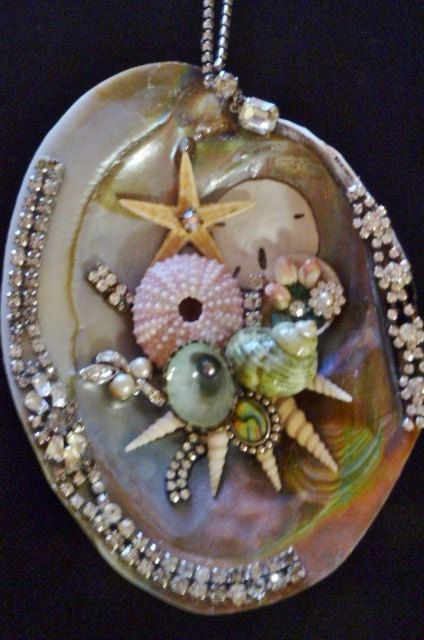 341 best seashell craft ideas images on pinterest sea for Kitchen cabinets lowes with seashell wall art craft
