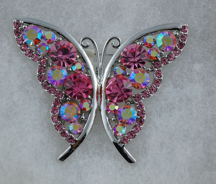 A personal favorite from my Etsy shop https://www.etsy.com/ca/listing/112352854/pink-butterfly-austrian-crystal-brooch