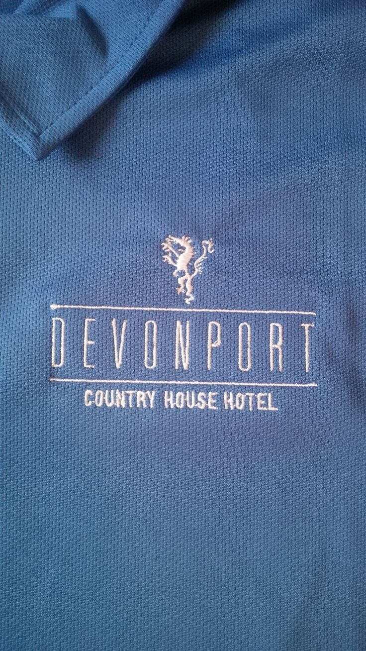A polo shirt embroidered with a fine print detail.