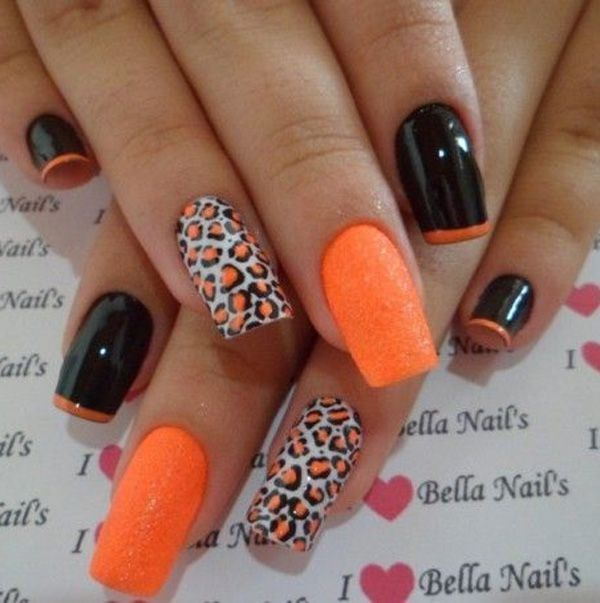 A splash of orange in a leopard nail art design. The black and orange combination on this nail art design is simply stunning.  The alternating designs give more dimension and depth into the nails.