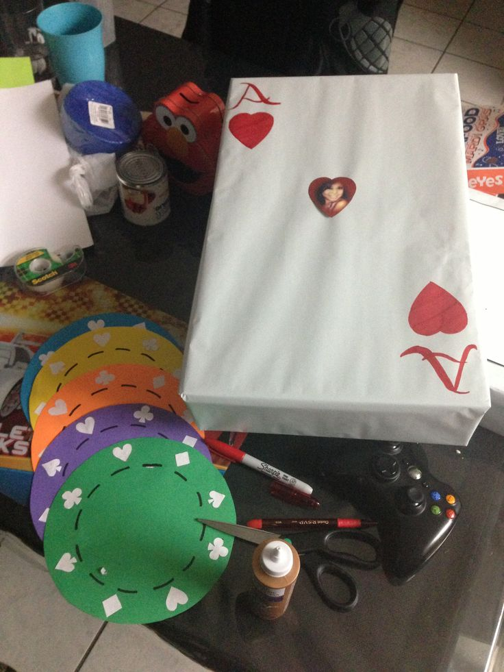 Casino theme party decorations. Large playing cards and poker chips