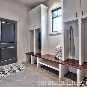 Veranda Interiors - gray tile herringbone floor,