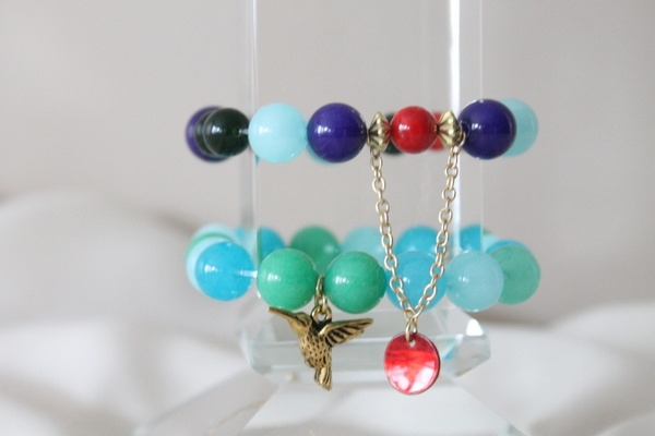 Turquoise and green beaded bracelet with dangling charm and dangling golden chain