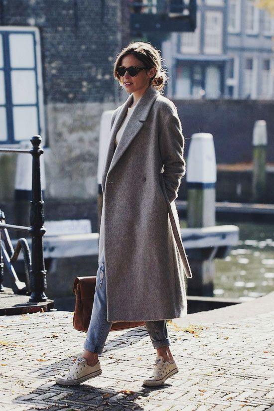 Shop this look on Lookastic:  http://lookastic.com/women/looks/sunglasses-coat-jeans-low-top-sneakers-satchel-bag/7767  — Black Sunglasses  — Grey Coat  — Light Blue Ripped Jeans  — White Low Top Sneakers  — Brown Leather Satchel Bag