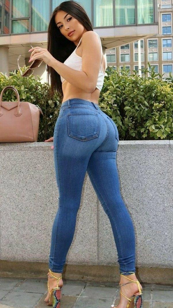Girl look model makeup hair wet t-shirt jeans tan wall