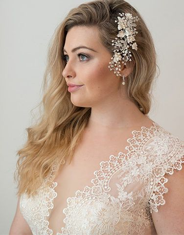 Gown and accessories by Peter Trends Bridal