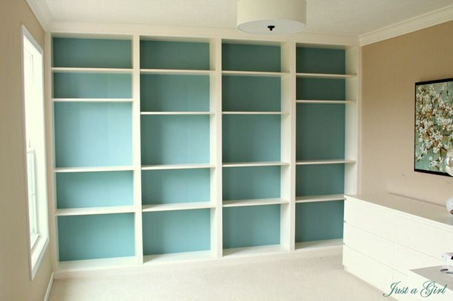 Built in Billy bookcases - Ikea hack, love the turquoise background