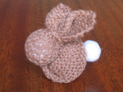 This bunny is so simple as it is made from a knitted square – any size is fine. (This one is in 8ply wool on 4mm needles and 28 stitches across.) With the same coloured wool (I have used contrastin…