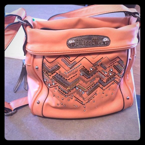 Miss me purse Coral-peach miss me purse with sequin like new used 4 times only! Miss Me Bags Shoulder Bags