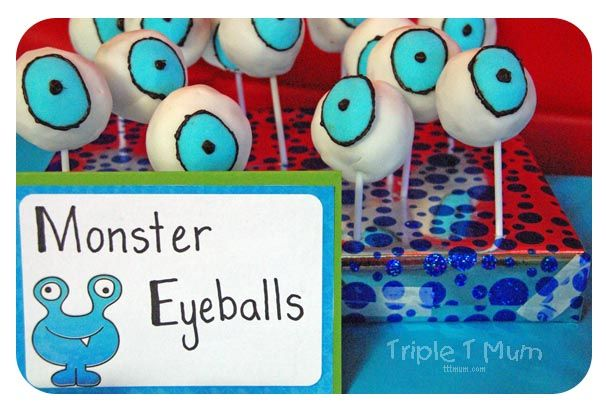 Monster Themed Party Food: Eyeballs. Fondant coated cake pops. Personality all of their own!