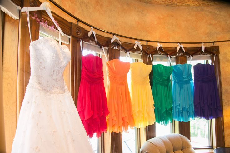 Rainbow bridesmaid dresses from David's Bridal with hangers with our names on them