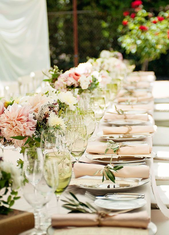 With fluffy blooms, vintage details, and a serene setting there's no denying the beauty of this table setup.