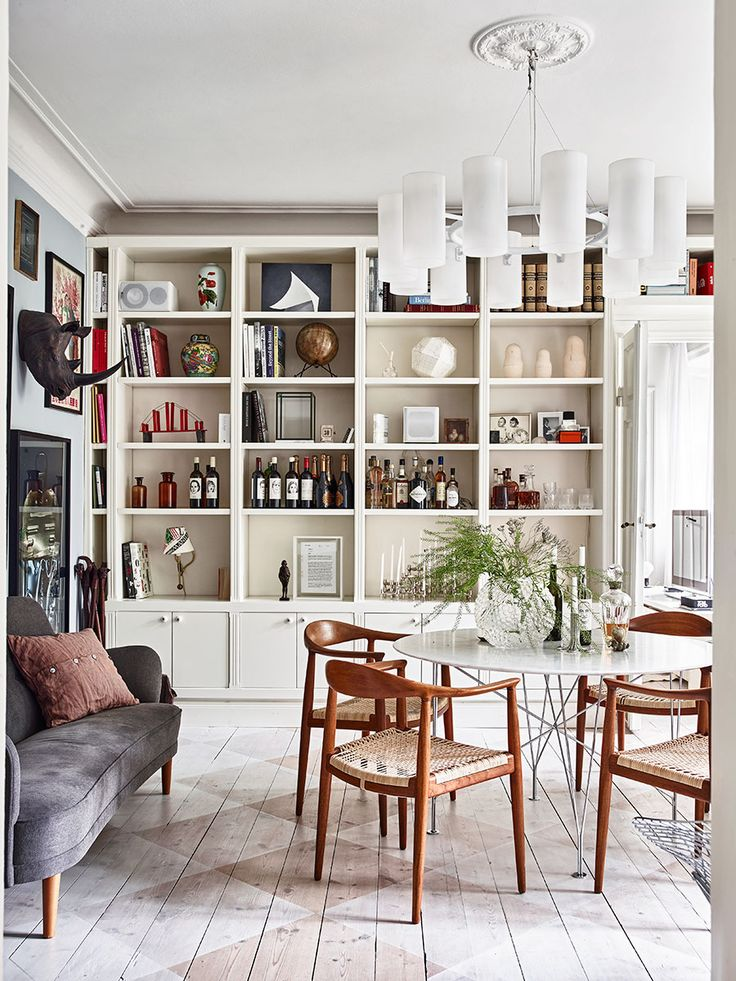 Monica And Rachelu0027s Kitchen Reimagined With Open Shelving And Mismatched  Dining Chairs