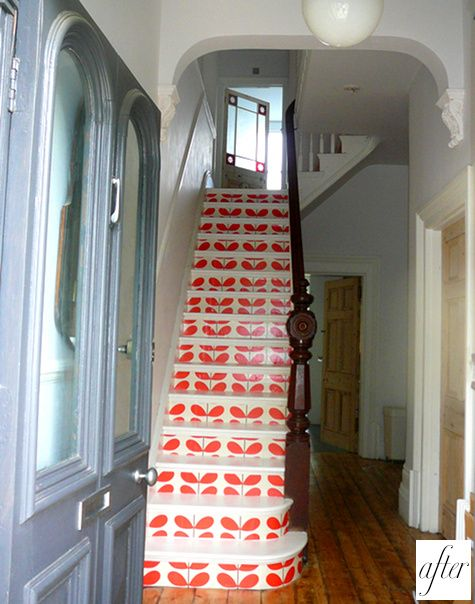 Orla Kiely wallpaper underneath each step of an staircase, love it!