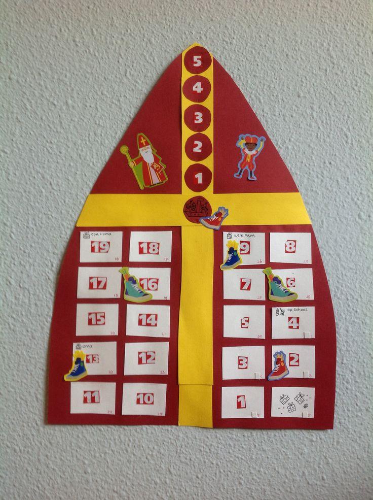 Sinterklaas aftelkalender. Tevens planner voor Sinterklaas. Eerst van boven naar beneden tot Sinterklaas op tv aftellen, daarna aftellen tot pakjesavond. Op de dagen dat ze het schoentje mogen zetten staat een schoentje. De cijfers hebben we uit het Intertoysboek geknipt. Veel knutsel en aftelplezier.