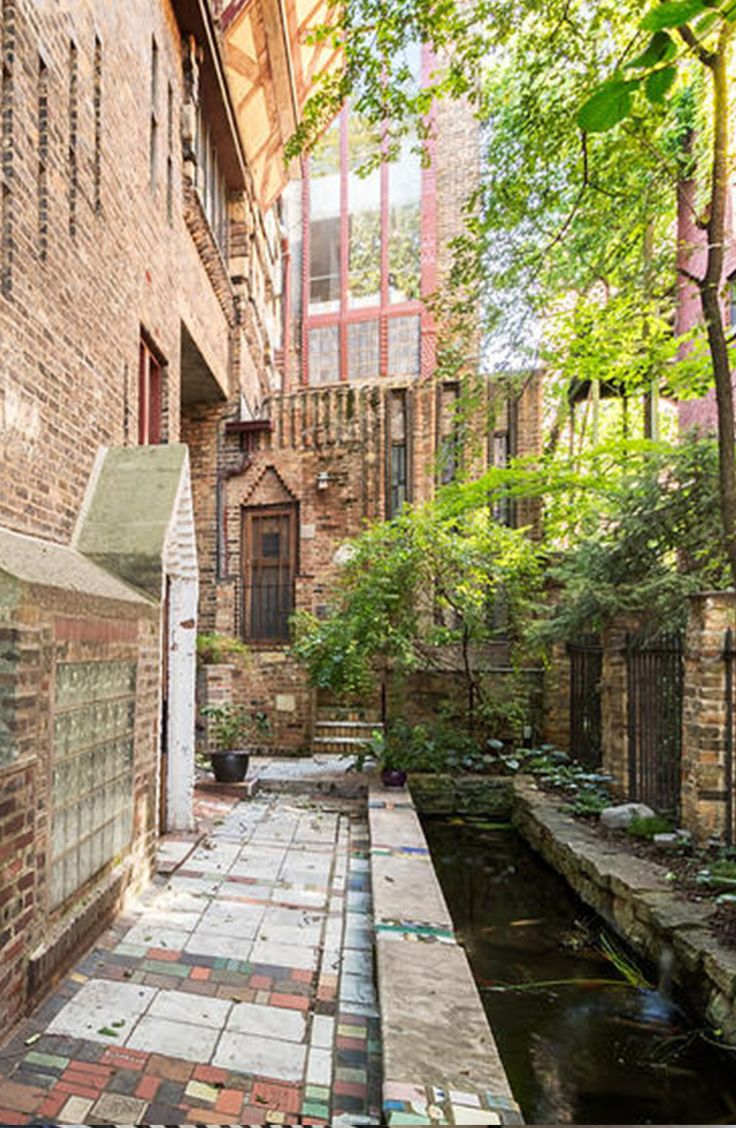 Victorian condo in Old Town with brick courtyard and stone pond