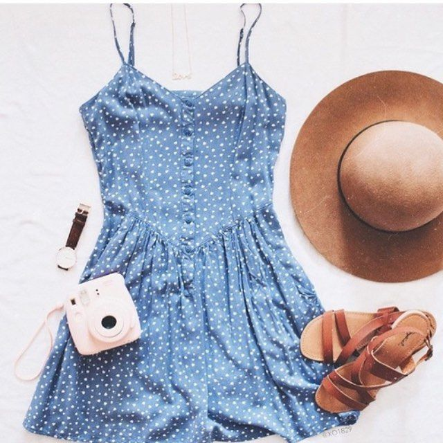 Blue flowy dress with camel-colored sandals.