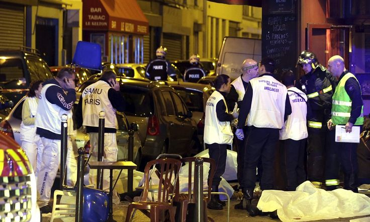 Paris attacks: shootings and explosions leave about 140 dead