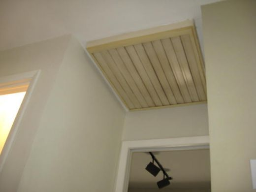 Whole House Fan Louver Cover | Whole house fan louvers view from the hallway