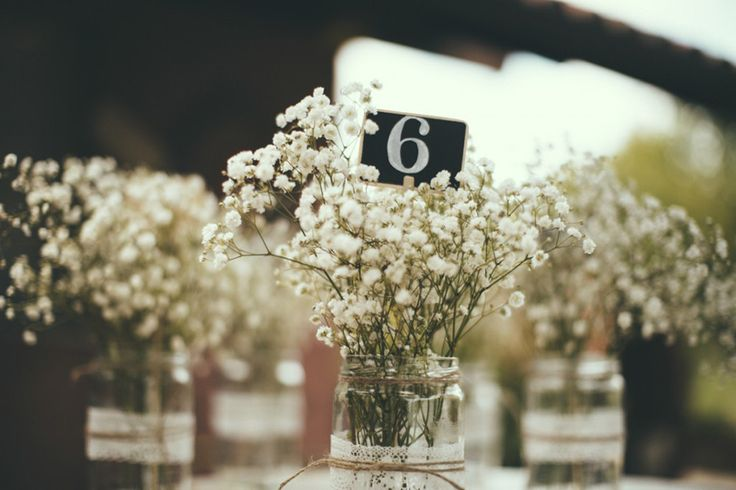 Gypsophila Baby's Breath in Jam Jars wrapped in Lace & Twine | Industrial Wedding | Destination Wedding | Italy | Intimate Reception | Images By Maria Bryzhko | http://www.rockmywedding.co.uk/lara-fabio/