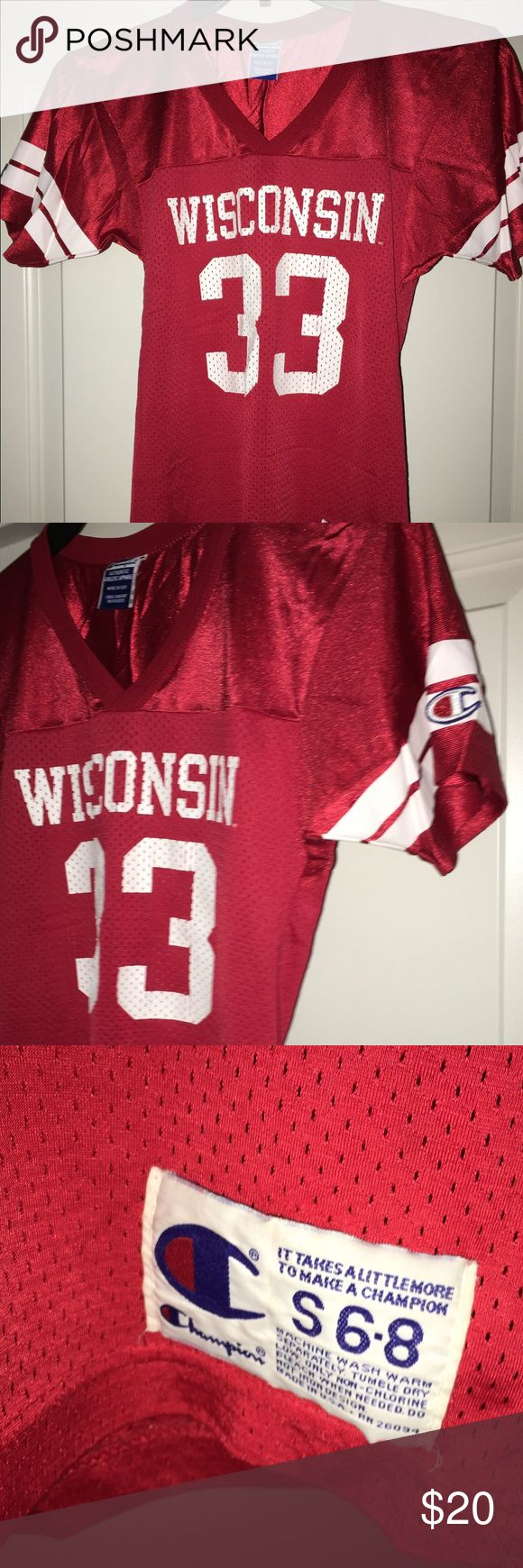 "Youth champion Wisconsin Badgers football jersey S for sale is a kid/youth, vintage, classic, all original, Champion brand, Wisconsin Badgers, red and white short sleeve football jersey.  Sz: S 6-8 Item is in good condition with no rips or stains. There is some cracking in the numbers on the screen print, but not terrible. Please see photos. If you have any questions please ask.  From under one arm to under the other measures appx 15"" from the top of the shoulder to the bottom of the Jersey…"