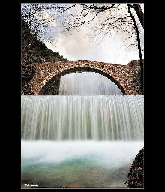 waterfalls and old stone bridge