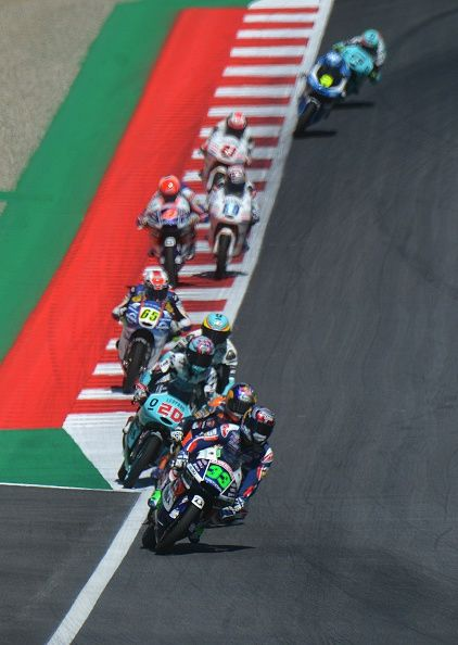 Enea Bastianini of Italy leads a pack during the Moto3 competition at the Grand…