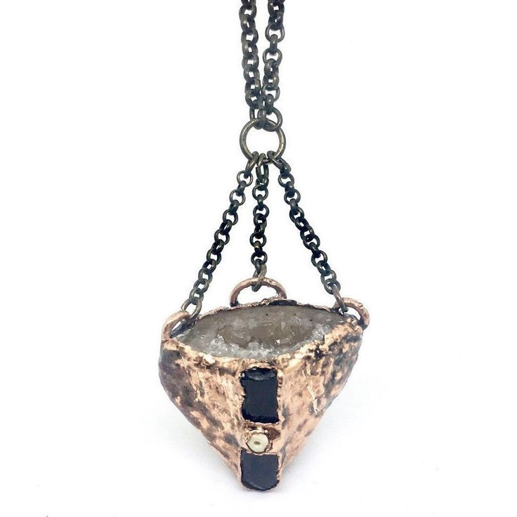 This necklace features a druzy geode cave, black tourmaline and opal on an antique brass chain. The pendant has been genuinely electroformed in thick, pure copper and is truly one of a kind.   Arrives gift ready in a boho lux gift box.  • Pendant dimensions (length x width):    Available upon req