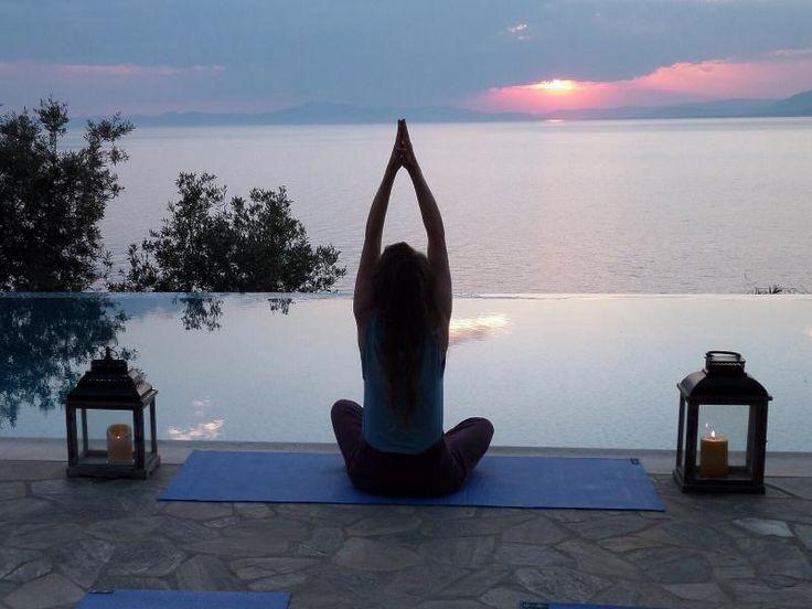 Sunset yoga in Oia village, Santorini island, Greece. - www.oiamansion.com