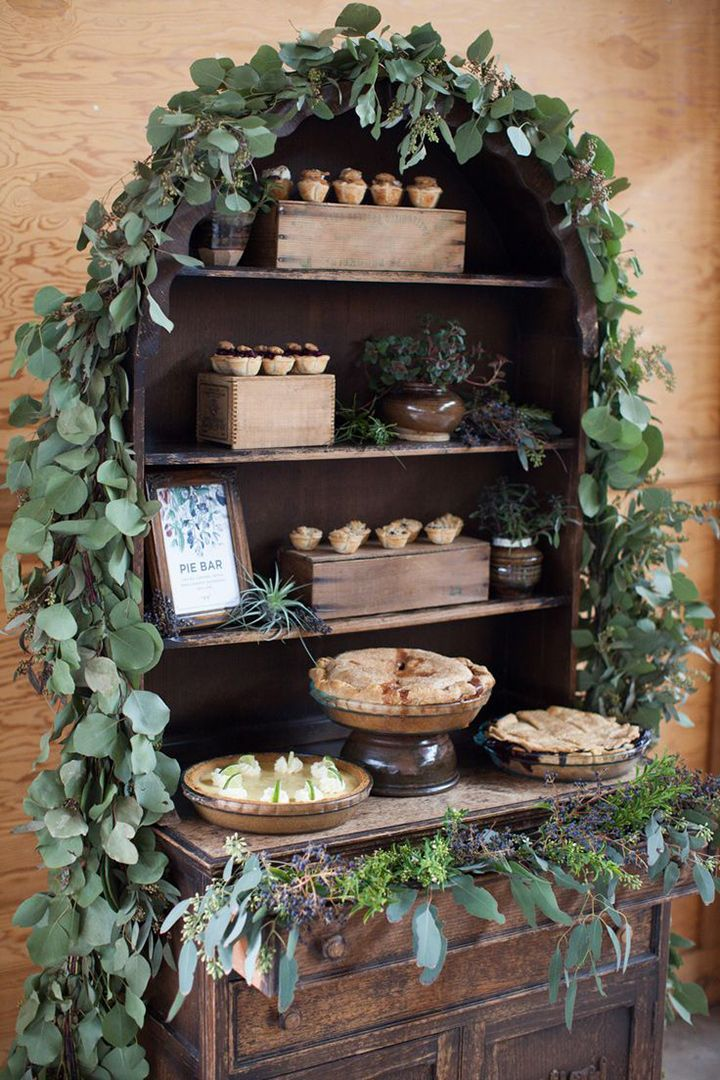Pies & mini pies arranged on a hutch festooned with fresh garland ~ we ❤ this! moncheribridals.com