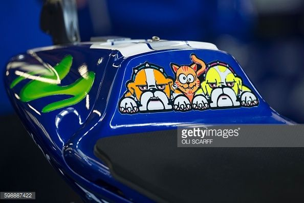 Cartoon artwork adorns the seat of the bike of the Movistar Yamaha MotoGP team's Italian rider Valentino Rossi, before the fourth MotoGP Free Practice session at the motorcycling British Grand Prix... Pictures | Getty Images