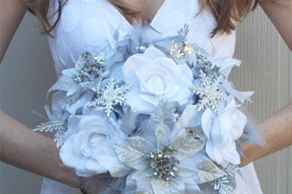 ice blue silver winter wedding bouquet with snowflake