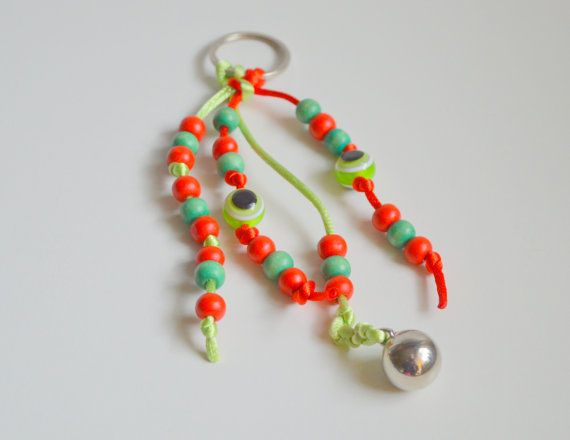 An impressive 2015 Good Luck #Key Chain to put your  home or #car keys.. It is made from  wooden beads.  From a metal silver metal ring ,hanged light green and red  cord  fr... #keychain #brelock #keys #house #key #holder #holidays #christmas #ornament #decoration
