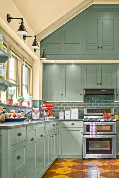 """A dramatic accent wall of blue/gray cabinets anchors the open floor plan of this charming Farmhouse kitchen. 