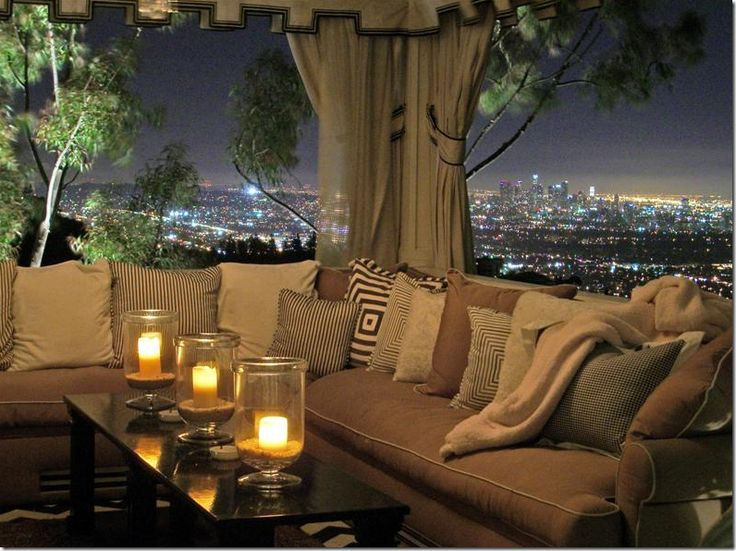 outdoor curtained area with lounging sofas, overlooking Los Angeles (English estate in Southern California) (Cote De Texas blog, Dec. 8, 2009: California Dreaming of the Lotto)