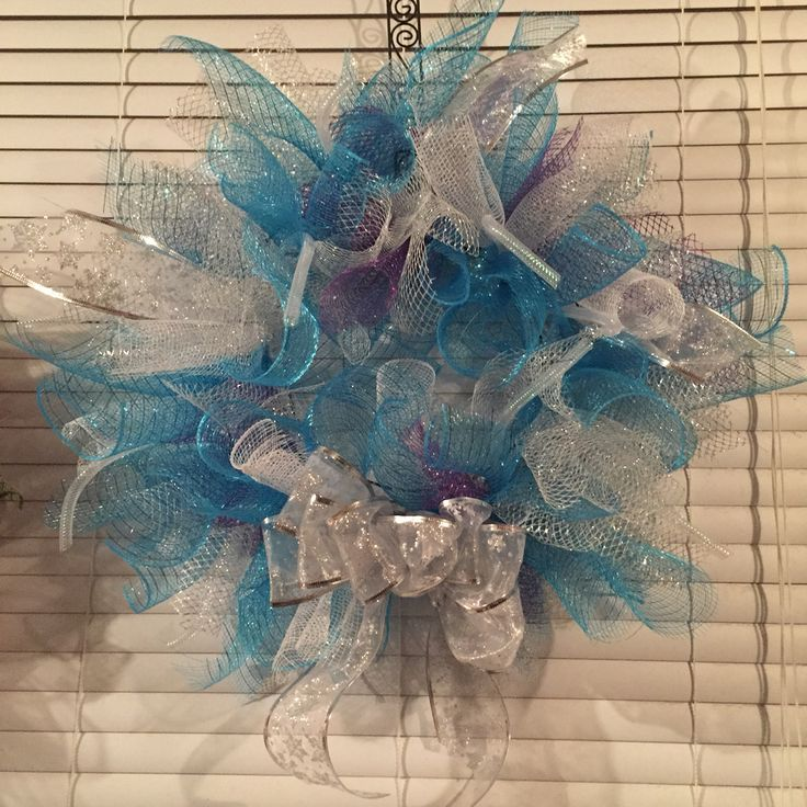 Silver blue and a touch of purple deco mesh wreath.