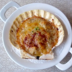 Coquilles St. Jacques - Julia Child's recipe for Scallops Gratineed with Wine, Garlic and Herbs.