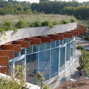 Earth Sheltered Housing: The Burrow -- An ultra-modern earth-sheltered home with floor-to-ceiling glass