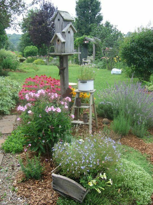 Flower bed and birdhouses garden containers pinterest for Rustic outdoor decorating