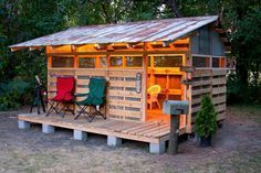 Pallet Playhouse my husband built with my dad for our daughter...so cute that we…