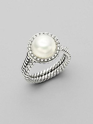 From David Yurman's Pearl Cable Wrap Collection. A circle of pavé diamonds surround a delicate pearl, freshwater and naturally-hued, with two cabled bands of sterling silver.