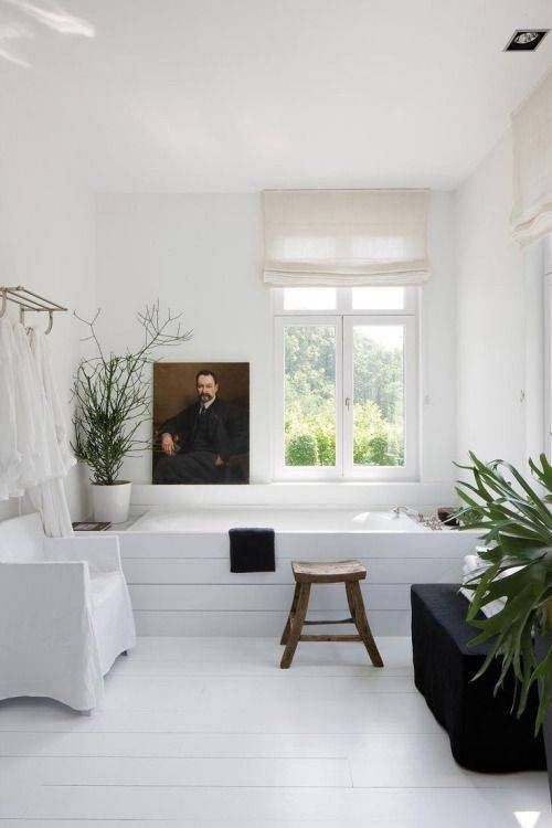 plants, art, and white modern decor