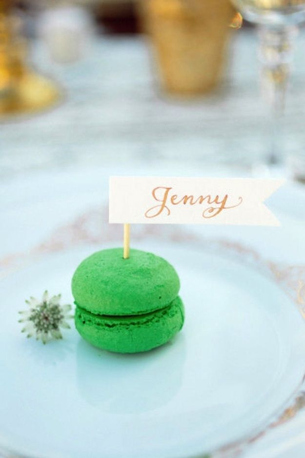 why not give your guests a taste of sweetness when you sit them at their table with a piece of dessert like this macaroon #placecards #wedding