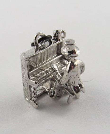 Pianist Mechanical Sterling Silver Charm For Bracelet by SilverHillz on Etsy https://www.etsy.com/listing/235083292/pianist-mechanical-sterling-silver-charm