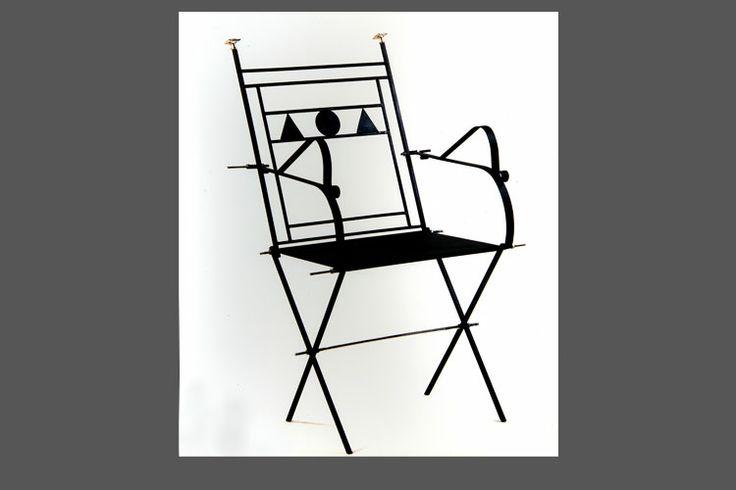 La sedia del Petrarca - seduta in ferro spazzolato imbullonata a mano.
