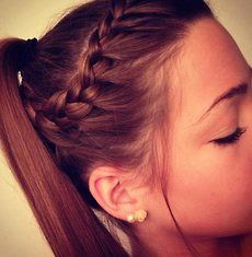 Adorable. It looks like a crown braid, adding hair only from the right side (closest to the face), taking it around to the back of the head. You probably pin it, then add the remaining hair to a high ponytail.